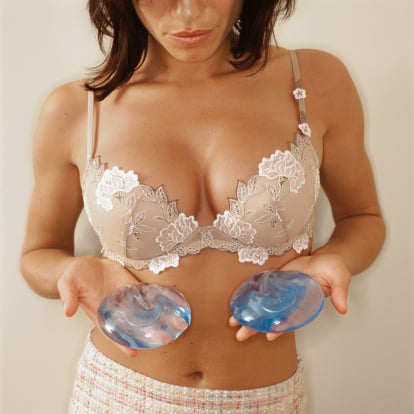 Woman trying to decide between silicone, saline, and gummy bear boob implants