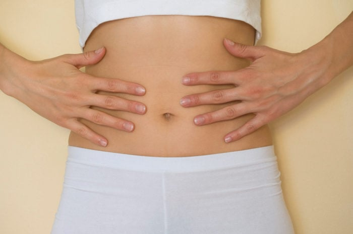 Touching stomach for tummy tuck page