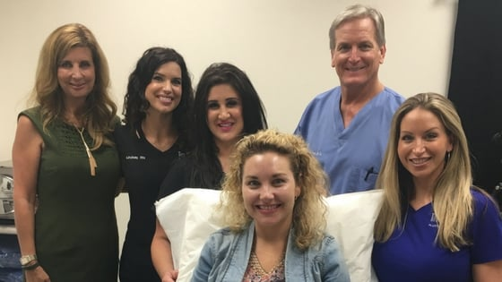 One of our patients after a peel with Dr. Love, our clinical staff, and SkinMedica representative.